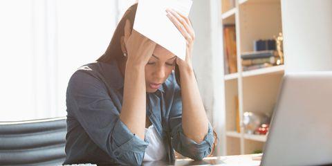 Anxious woman sat at desk