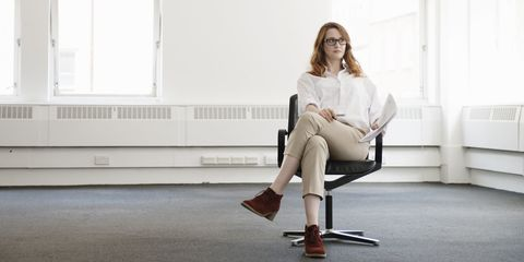 Woman siting down in office