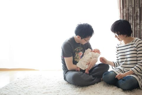 Couple at home with newborn baby