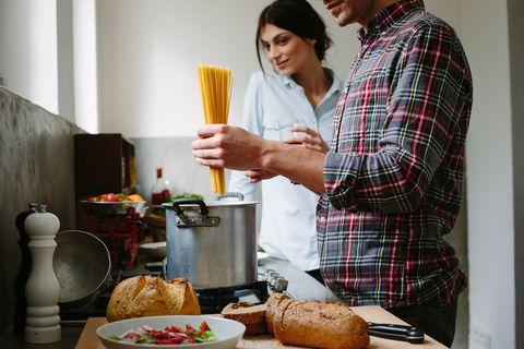 Couple cooking spaghetti pasta