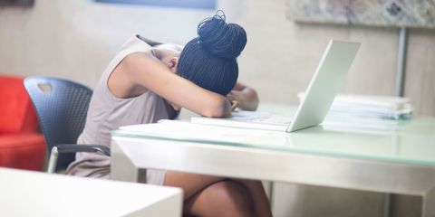 woman upset at desk