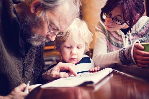 Family doing crossword puzzle