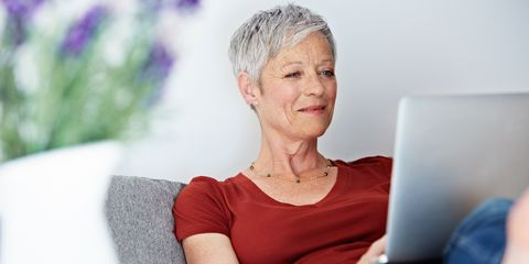 older woman on a laptop