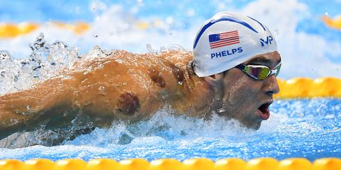 RIO DE JANEIRO, BRAZIL - AUGUST 08: Michael Phelps of the United States competes in the Men's 200m Butterfly heat on Day 3 of the Rio 2016 Olympic Games at the Olympic Aquatics Stadium on August 8, 2016 in Rio de Janeiro, Brazil. (Photo by Laurence Griffiths/Getty Images)