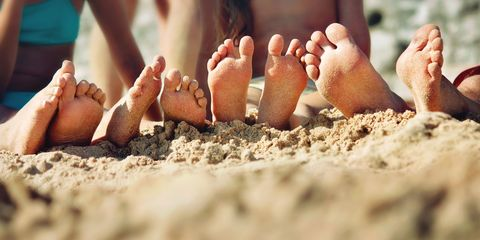 Barefoot family on the sand