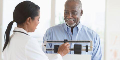 Black man being weighed