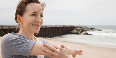 Smiling woman running on beach