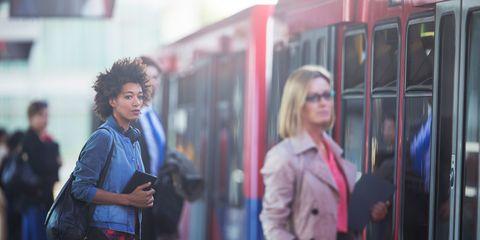 People commuting via train