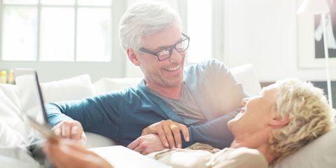 Older couple relaxing together on sofa