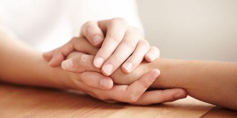 Friends holding hands