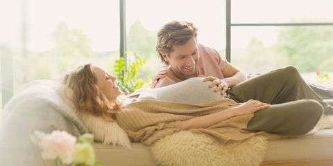 Couple pregnant woman hand on stomach