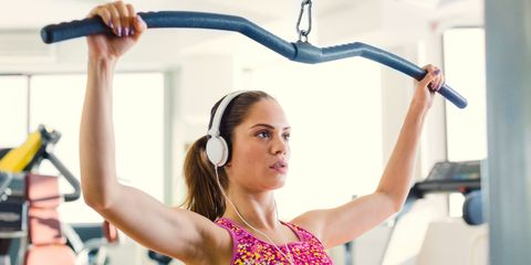 Girl in gym headphones
