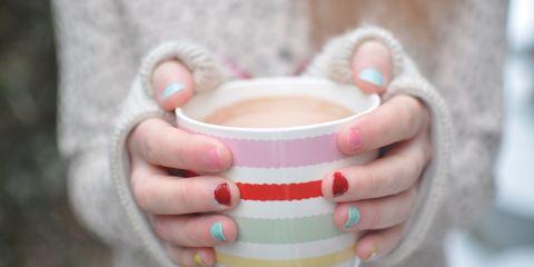 Woman holding mug of hot chocolate