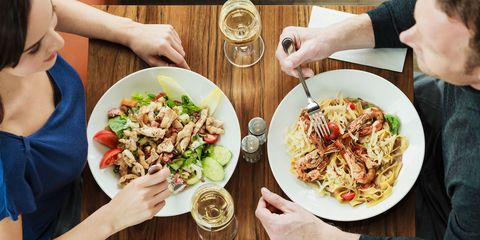 Couple having dinner and white wine at a restaurant