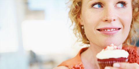 Woman eating red velvet cake