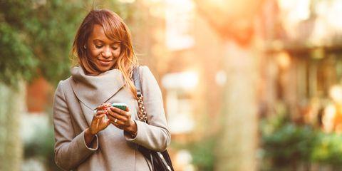 Woman smiling looking at phone