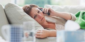 Woman with cold on the telephone