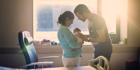 Parents with new born baby in hospital