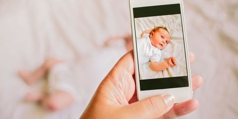 Taking photo of baby on smartphone