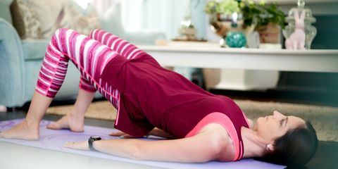 Woman doing pilates in living room