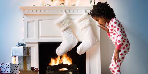 Young girl surprised at stockings from santa