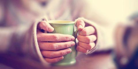 Woman with mug of tea