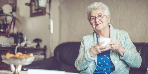 Smiling older woman with hot drink
