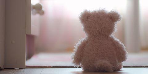 Lonely teddybear discarded on floor