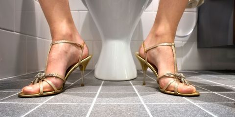 Woman on the toilet with cystitis uti