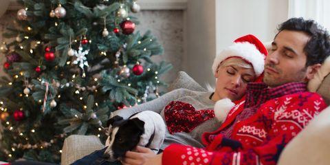 Young couple at Christmas having a nap on the sofa