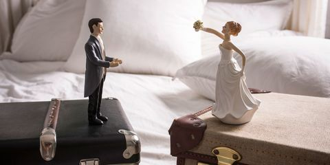 Divorce wedding figurines separated on suitcases