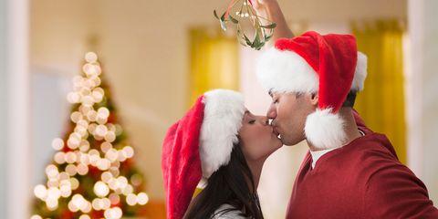 Couple kissing under mistletoe