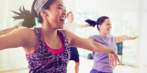 Woman happy and confident in gym doing aerobics