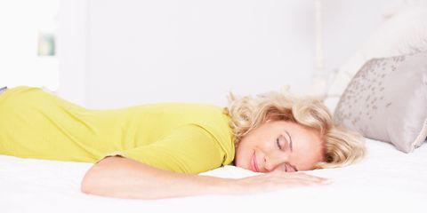 Woman getting good sleep on comfortable bed