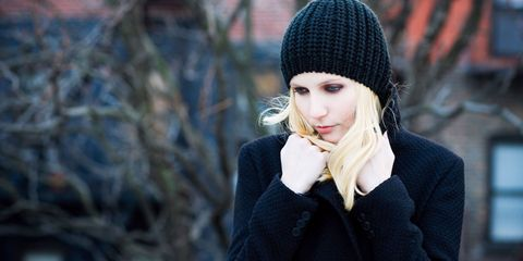 Sad young women wearing a woolly hat in winter