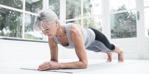 Older woman trying yoga