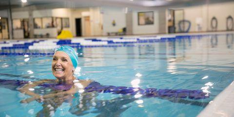 Smiling woman in swimming pool