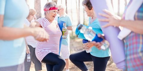 Two older women exercising together