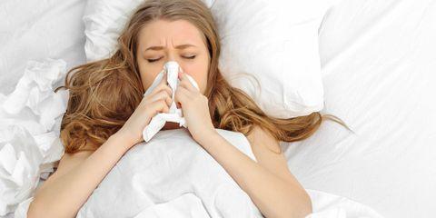 Woman feeling ill with flu
