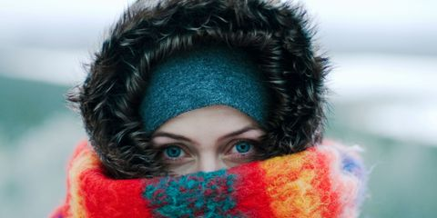 Woman wearing a scarf covering her face