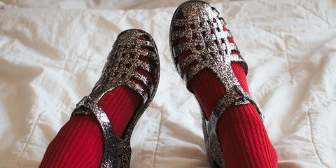 Woman Wearing Red Socks And Sandals On Bed