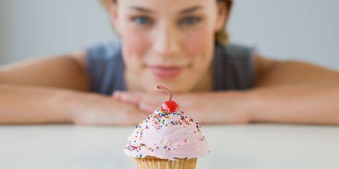 Woman eyeing up cake