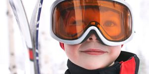 Boy on a skiing holiday wearing goggles