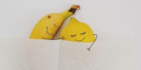 Banana and lemon sleeping in bed