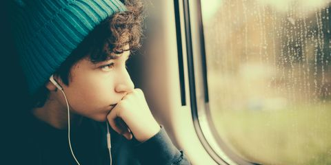 Teenager looking out of train window