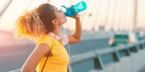 Runner drinking water