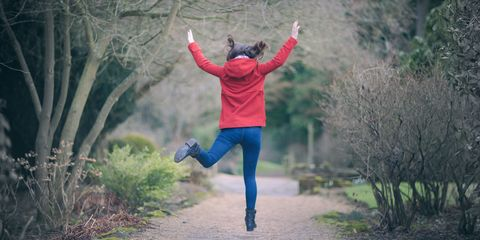 Woman jumping for joy in a park