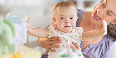 Baby with down's syndrome and mum at birthday party
