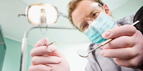 A dentist examining a patient