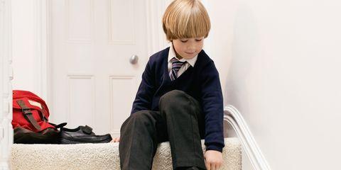 Little boy getting ready for school